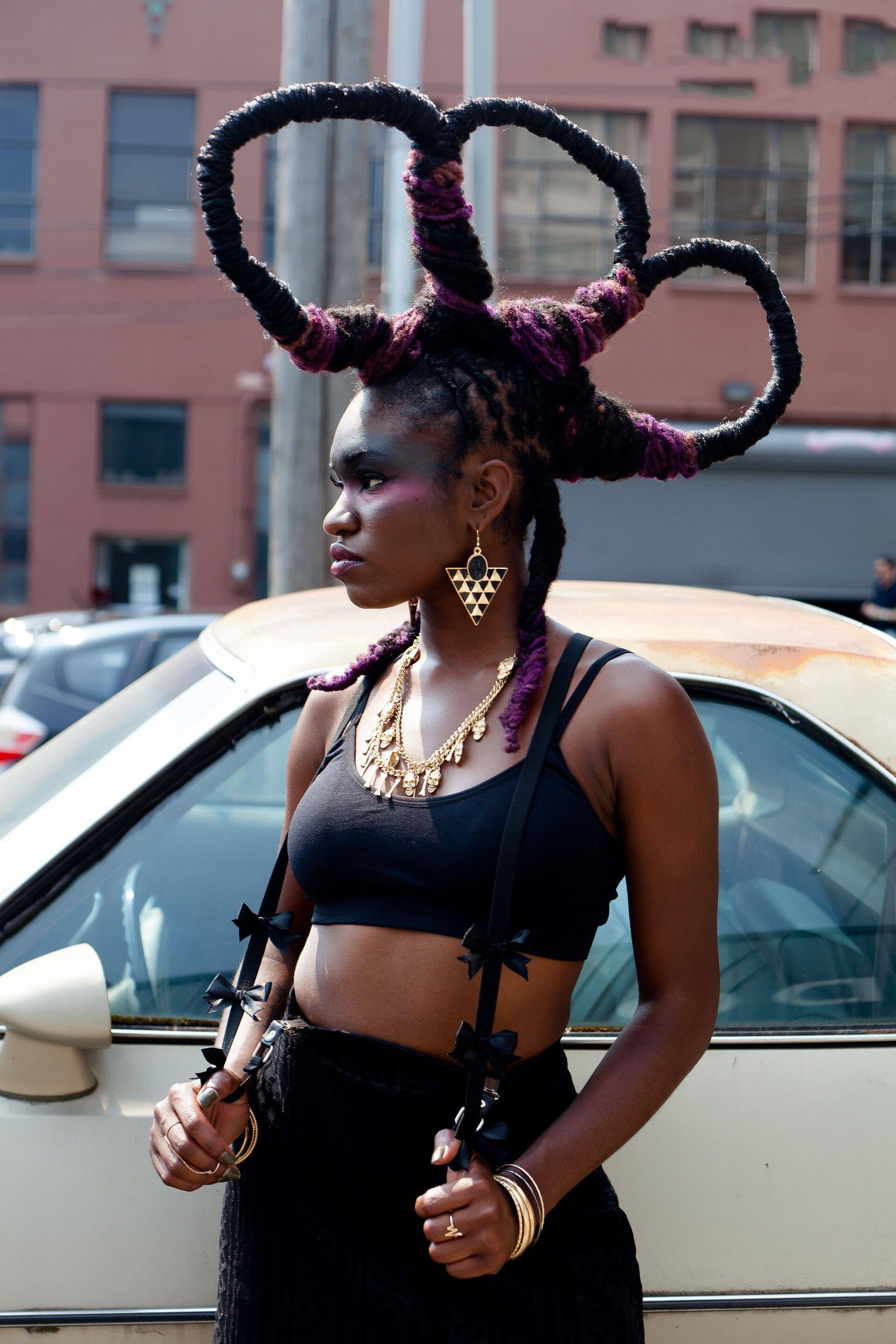 woman with dreads styled into looped mohawk