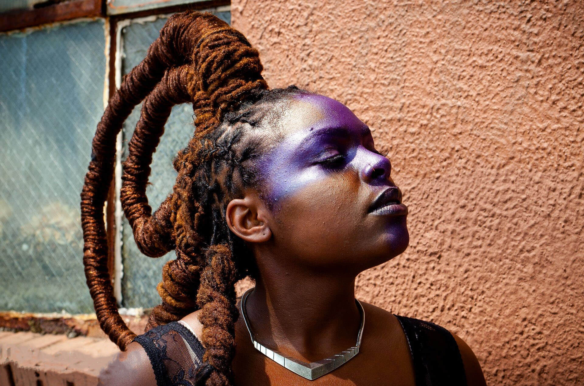 woman with dreads styled into crown